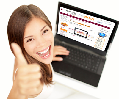 girl with thumbs up at laptop