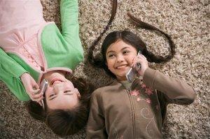 girls using cell phones